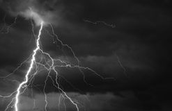 Fork lightning striking down during summer storm Royalty Free Stock Photography
