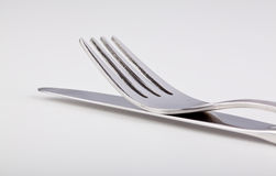 Fork lying on top of the knife Stock Photography