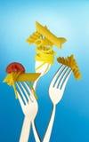 Fork with macaroni and spaghetti Stock Photos
