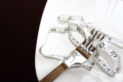 Fork and measure tape Royalty Free Stock Image