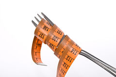 Fork and measuring tape Stock Image