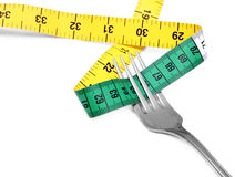 Fork and measuring tape Stock Photography