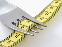 Fork with measuring tape Stock Photos