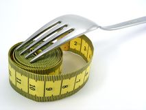 Fork with measuring tape Royalty Free Stock Photo