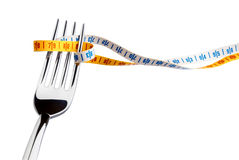 Fork and measuring tape. For a healthy lifestyle royalty free stock photos