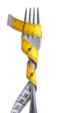 Fork and measuring tape royalty free stock photo