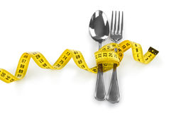 Fork and measuring tape Royalty Free Stock Photography
