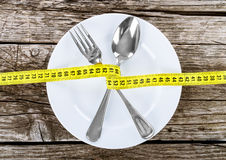 Fork and measuring tape Stock Images