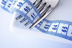 Fork With Metric Tape Measure Entwined Stock Photo