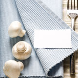 Fork and mushrooms on blue napkin Royalty Free Stock Images