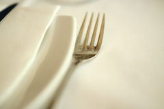 Fork and napkin. Shallow depth of field shot of a fork and white plate and napkin Royalty Free Stock Images