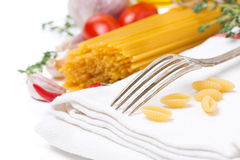 Fork, napkin, pasta and spices, selective focus, isolated Stock Photography