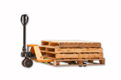 A fork pallet truck stacker with stack of wooden pallets  Stock Photos