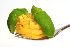 Fork with pasta and basil Stock Photos