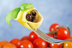 Fork with pasta,basil and olive Royalty Free Stock Image