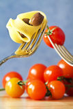 Fork with pasta, tomato and olive Royalty Free Stock Photography