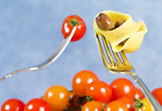 Fork with pasta, tomatoes and olive Royalty Free Stock Images
