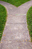Fork in the pathway. With grass Royalty Free Stock Photo
