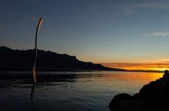 Fork.People. Sunset. Geneva Lake. Silhouette. Sky stock photography