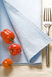 Fork and peppers on blue napkin Stock Photo