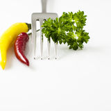 Fork with peppers and parsley Royalty Free Stock Images