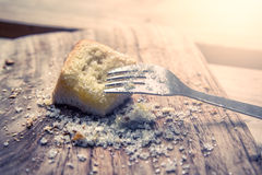 Fork on piece of sweet toast with sugar on wooden plate Royalty Free Stock Photos