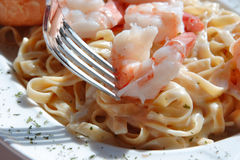 Fork piercing Shrimp Alfredo Royalty Free Stock Photo