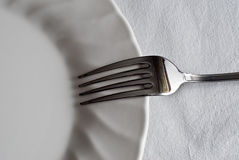 Fork on the plate. Stock Photo