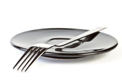 Fork on plate Royalty Free Stock Images