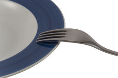 Fork and plate. One fork on blue plate with white background stock images