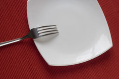 Fork and plate Stock Photo