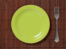 Fork with plate Stock Images