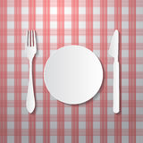 Fork, Plate and Knife on Tablecloth Stock Photo
