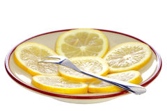 Fork on a plate with lemon Stock Image