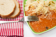 Fork on a plate with pasta and bolognese sauce Stock Images