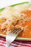 Fork on a plate with pasta and bolognese sauce Stock Photos
