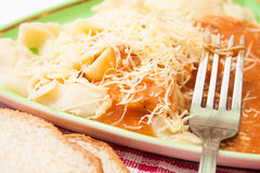 Fork on a plate with pasta and bolognese sauce Stock Photo