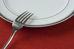 Fork and porcelain plate Royalty Free Stock Photo