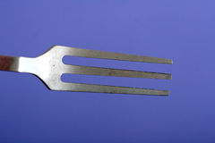 Fork on purple Stock Photography