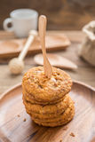 Fork put on Stacked cookies and wood dish Stock Photos