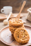 Fork put on Stacked cookies and wood dish ,Focus On Foreground Stock Image