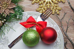 Fork with red bow and balls on new year's Eve Royalty Free Stock Photography