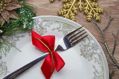 Fork with red bow on new year's Eve royalty free stock image