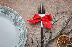 Fork with red bow on new year's table royalty free stock photography