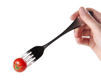 Fork with red Fresh tomato. Ready to eat stock images
