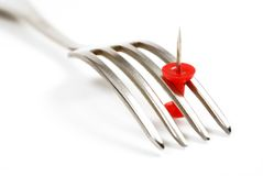 Fork and red pushpin. Fork and pushpin isolated. Conceptual photo Royalty Free Stock Photo