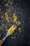 Fork with remains of couscous on black stone Royalty Free Stock Photography