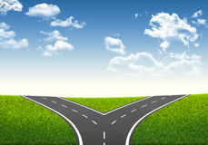 Fork in the road. Decision-making framework. Blue sky and grass stock illustration