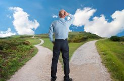 Fork in the road. Man at fork in the road concept image royalty free stock photos