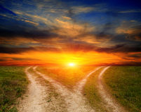 Fork roads in steppe on sunset background Royalty Free Stock Photo